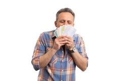 Man kissing cash money. Rich man kissing cash money bills in hand isolated on white studio background stock photos