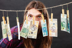 Rich man with laundry of money. Riches and fortune. Young happy man with a lot of money on black background. Winning the lottery concept stock images