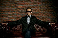 Rich man. Portrait of an imposing well dressed man in sunglasses. Luxury. Men`s beauty, fashion Royalty Free Stock Photo