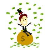 Rich Man Sitting On y hace que llueve su dinero Imagen de archivo libre de regalías
