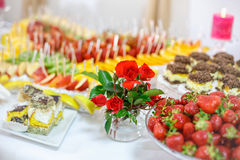 Rich many fresh fruits on luxury wedding table at the reception. Royalty Free Stock Images