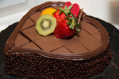 Rich milk chocolate cake with strawberry topping. Royalty Free Stock Photography