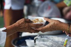 Rich people give food to the poor. starvation concept.  stock image