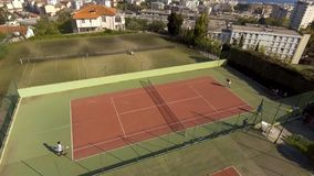 Rich people playing tennis at luxury court, leisure activities, sport weekend. Stock photo royalty free stock photography