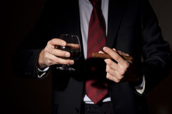 Rich person, holds a cigar and whisky Stock Photography