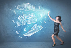 Rich person throwing hand drawn car yacht and house Stock Photography