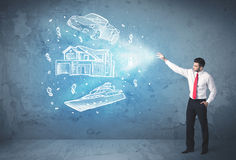 Rich person throwing hand drawn car yacht and house Stock Images