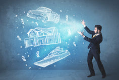 Rich person throwing hand drawn car yacht and house Royalty Free Stock Image