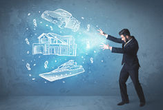 Rich person throwing hand drawn car yacht and house Stock Photos