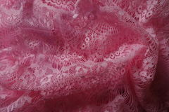 Rich pink guipure lace in folds Stock Image