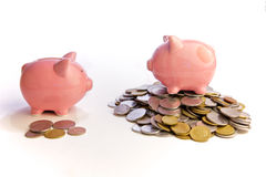 The rich and the poor. A rich pig and a poor one royalty free stock photos