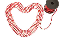 Rich red beads in the shape of a heart. Stock Photography