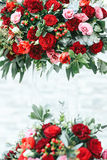 Rich red bouquets of roses, peonies and ranunculus in the glass Royalty Free Stock Photos