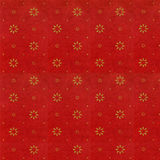 Rich red with tiny gold flower. Rich red textured background with tiny gold flowers Stock Image