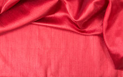 Rich red wavy fabric background. Stock Photos