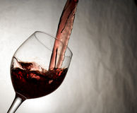Rich red wine poured smoothly Royalty Free Stock Photos