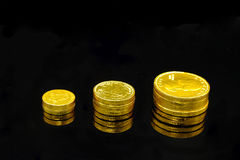 Rich and richer. A stack of chocolate gold coins symbolizing success and wealth Stock Photography