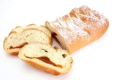 Rich roll. The rich ruddy roll is strewed by powdered sugar with a stuffing from dried apricots on a white background Stock Photography