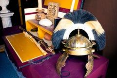 Rich Roman helmet on working desk Royalty Free Stock Photography