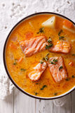Rich salmon soup with thyme close-up on the table. vertical top Stock Image