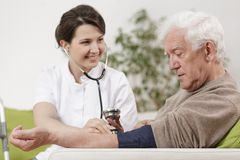 Rich senior during home appointment. Image of rich senior during home medical appointment stock photos
