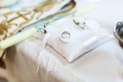 Rich stylish unusual platinum rings. On the pilov Stock Photography