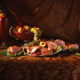 Rich table. Fruits, meat, victorian style on the table Stock Images