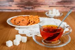 Rich tea in a glass Cup. cookies and refined sugar Stock Images