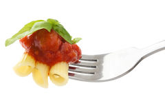 Rich tomato sauce, pasta and basil on a fork Stock Images