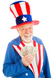 Rich Uncle Sam. Realistic Uncle Sam smiling and holding a hand full of cash. Isolated on white royalty free stock image