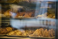 A rich variety of buns pies, donuts in a typical confectionery shop window. Baked buns in the bakery. Sweet dessert food closeup. Baked buns in the bakery royalty free stock photography