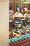 Rich variety of chocolates and candies in display window  of italian pastry Stock Images