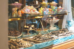 Rich variety of chocolates and candies in display window  of italian pastry Royalty Free Stock Photo