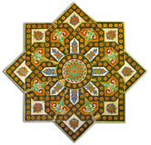 Rich vintage tiled pattern decoration. Ancient tiled pattern with arabesques stock image