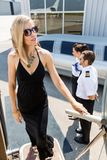 Rich Woman Boarding Private Jet royalty-vrije stock foto