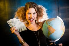 Rich woman with a globe Royalty Free Stock Image
