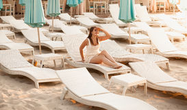 Rich woman relaxing on beach at hotel Royalty Free Stock Photo