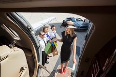Rich Woman With Shopping Bags Boarding Private Jet Royalty Free Stock Image