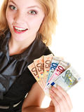 Rich woman showing euro currency money banknotes. Royalty Free Stock Photo