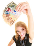Rich woman showing euro currency money banknotes. Royalty Free Stock Images