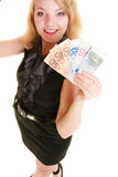 Rich woman showing euro currency money banknotes. Stock Image