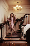 Rich woman on staircase with a candle Royalty Free Stock Image