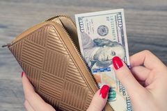 Rich woman taking from purse money. Overhead top above close up view photo royalty free stock image