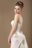 Rich Woman in White Dress with Bow Knot Royalty Free Stock Images