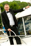 Rich yacht owner. Portrait of elegant businessman, a yacht owner Royalty Free Stock Image