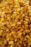 Rich yellow dried raisins. A lot of appetizing yellow raisins, pattern, dried grapes Royalty Free Stock Photos