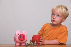 Rich young boy. A young boy thinks about his money Stock Images