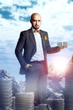 Rich young man in a business suit with a bunch of money Stock Image