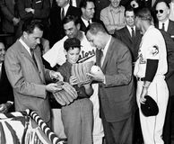 Richard M. Nixon at Orioles-Senators game. Future President of the United States Richard M. Nixon checks out players gloves with a young Washington fan at an Stock Photography