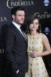 Richard Madden & Jenna Coleman. LOS ANGELES, CA - MARCH 1, 2015: Richard Madden & actress girlfriend Jenna Coleman at the world premiere of his movie Cinderella royalty free stock images
